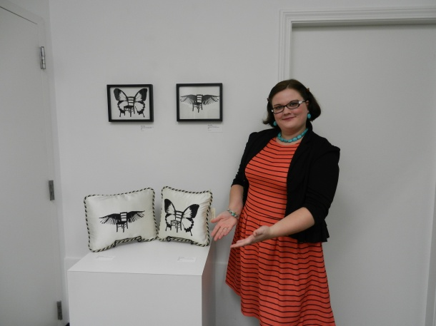 "Me with my ""If Chairs Could Fly"" prints on paper and my handmade dupioni silk pillows. On display a Arcworks Community Art Center"